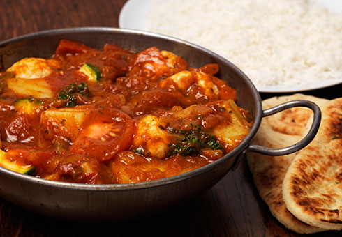 Heaton Balti Stockport sizzling spicy chicken balti dish served with naan bread