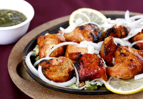 Chicken tandoori on a bed of salad