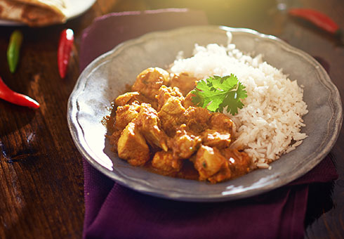 Little Indian Wirral delicious chicken curry with a side iof delicate white rice